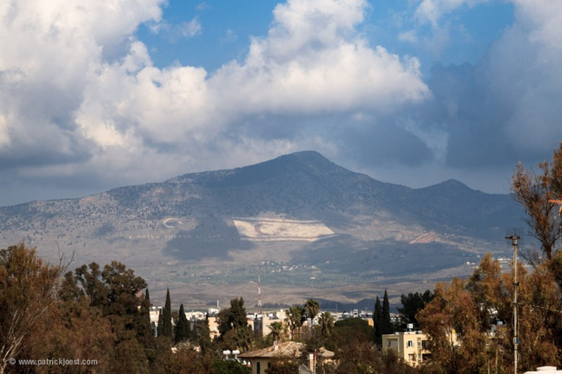 Turkish flag in the North. View from Lefkosia in the South